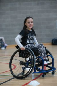 Young wheelchair basketball player smiling